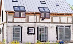 Ukryte odwodnienie dachu, czyli rynny i rury spustowe, których nie widać