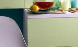 Trzy pomysły na kuchnię. W kolorach: zielonym, szarym i pomarańczowym
